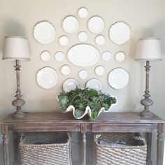 Neutral dining room decor:  white plate wall and a huge clamshell filled with succulents.
