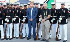Prince Harry took some time to pose with the U.S. Marine Corps Silent Drill Platoon before the start of the opening ceremony.