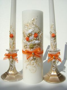 Unity candle set, perfect wedding candles for your unity ceremony, hand decorated with fabric roses and bows in orange, gold, ivory & white. $69.00, via Etsy.