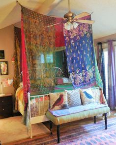 Gypsy bohemian bed canopy made by Babylon Sisters. Create a bohemian haven wherever in the world you happen to be.. Easy to hang from hooks in your ceiling with the included corner hooks... Babylon Sisters gypsy curtains are made from materials collected from near and far. We gather up the silk and lace left around the fire after the gypsies have stolen away into the night. Our creations are based on beauty and inspiration - NOT perfection. Fabrics have been freshly washed but will show…