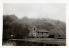 The huge Black Sunday storm—the worst storm of the decade-long Dust Bowl in the southern Plains—just before it engulfed the Church of God in Ulysses, Kansas, April 14, 1935. Daylight turned to total blackness in mid-afternoon.
