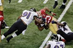 San Francisco 49ers running back LaMichael James (23) fumbles the ball as he is hit by Baltimore Ravens linebacker Courtney Upshaw (91) and Corey Graham (24) during the first half of the NFL Super Bowl XLVII football game Sunday, Feb. 3, 2013, in New Orleans. (AP Photo/Charlie Riedel)