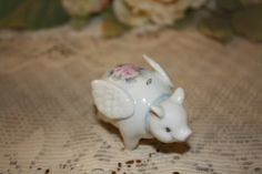Flying china Pig With Pink Roses and Blue Neck by DonnaRoberson