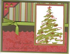 My cards tend to look like this when I can't come up with anything else!  You can't really tell that I embossed the trim on the tree.  I'm in need of some inspiration to finish up my Christmas Cards!