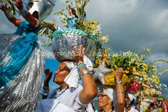 Baiana women carry religious figurines during the ritual procession in honor to Yemanjá, the Candomblé goddess of the sea, in Amoreiras, Bahia, Brazil, 3 February 2012. Yemanjá, originally from the ancient Yoruba mythology, is one of the most popular orixás, the deities from the Afro-Brazilian religion of Candomblé. Every year on February 3rd, hundreds of Yemanjá devotees participate in a colorful celebration in her honor. Faithful, usually dressed in the traditional white, gather at the…