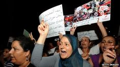 Tunisian women shout slogans during a protest calling for the respect of women's rights