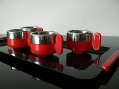 1980s Italian design espresso coffee set with black metal tray and red melamine handles.