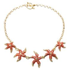 Add a pop of coastal style to evening ensembles and work outfits alike with this whimsical handmade necklace, showcasing an array of charming starfish pendan...