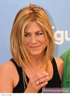 To add more oomph to her fine locks, Jennifer Aniston's had razored layers snipped in which add more swing to her shoulder-length locks. Dimensional hair highlights and subtle texture finishes the ...