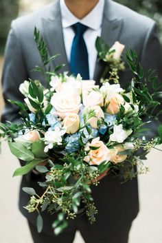 Groom with bouquet |
