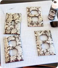 I glued scrapbook paper to the switchplates, let it dry, then cut excess paper away with a razor blade, sprayed with clear varnish. This is a great way to update switchplates and for sure isn't going to cost hardly anything.