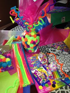 LISA FRANK Centerpiece or decoration!! Ladies/ and gents this here is my creation for a beautiful and very colorful and Fun table centerpiece! You need the following 1. Chenille Stems (cleaning pipes) 2. Pompoms  3. A Vase 4. Tissue paper  **all at the dollar store  Twist the pipes around your pointing finger and pull off !!