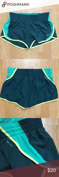 Nike Dri-Fit Shorts Nike Dri-Fit shorts in dark green, aqua and yellow colors. Wide elastic waistband, fit a bit shorter than Tempos. Size S. Nike Shorts