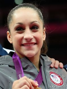 Jordyn Wieber of the United States poses with the gold medal after helping the United States win the Artistic Gymnastics Women's Team final on Day 4 of the London 2012 Olympic Games at North Greenwich Arena on July 31, 2012 in London, England