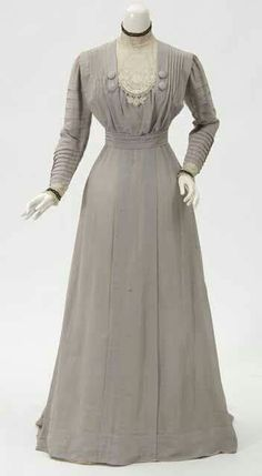 Grey silk poplin day dress with hand stitched tucks.White cotton lace bib and standing collar. Trimmed with black velvet ribbon at collar and cuffs. From Minnesota Historical Society http://tinyurl.com/zgwbtgt
