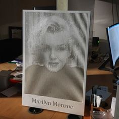 Marilyn Monroe routed on white foam board using halftone technique. As the board is solid white, only shadows reveal the image and letters.