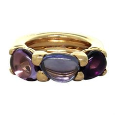 New Pomellato gold three stone ring with amethyst and iolite,from Sassi collection DESIGNER: Pomellato MATERIAL: 18K Gold GEMSTONE: Amethyst, Iolite RING: STYLE Ring DIMENSIONS: ring size - 7, ring is