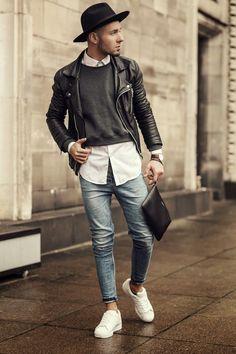 Shop this look on Lookastic:  https://lookastic.com/men/looks/biker-jacket-crew-neck-sweater-dress-shirt-skinny-jeans-low-top-sneakers-zip-pouch-hat-watch/9744  — Black Wool Hat  — White Dress Shirt  — Charcoal Crew-neck Sweater  — Black Leather Biker Jacket  — Dark Brown Leather Watch  — Black Leather Zip Pouch  — Light Blue Skinny Jeans  — White Low Top Sneakers