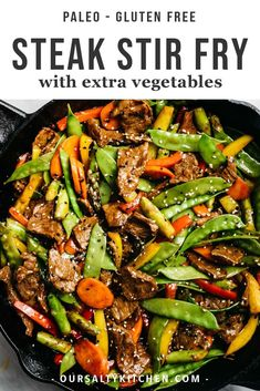 This steak stir fry with all of the vegetables is a weeknight superhero! Tender shreds of beef are tossed with five different rainbow vegetables in a paleo, gluten free, and sugar free stir fry sauce that doesn't sacrifice an ounce of flavor. Ready in just about 30 minutes, this healthy weeknight dinner is loaded with nutrients and couldn't be easier to make. Ditch the take out, elevate your stir fry game, and make this healthy beef stir fry! #paleo #glutenfree