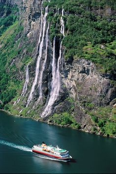 'Hurtigrouta' passes Seven Sisters Waterfall, Near Geiranger, Norway - Photo by Tom Schandy