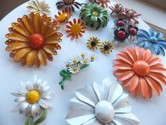 A bouquet of Enamel Flower Brooches and Earrings