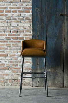 BAR STOOL WITH UPHOLSTERED LEATHER LOW CAMEL BACK SEAT OVER INDUSTRIAL PIPE LEGS AND H STRETCHER **H930 L520 D560**