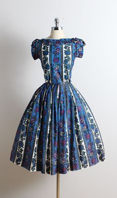 ➳ vintage 1950s dress  * nylon/ polyester blend * woven cotton lining * blue, purple floral print * bow accent * metal back zipper * by Manford  condition | excellent  fits like xs/s  length 43 bodice 17 bust 36 waist 26 bodice allowance 1.5 hem allowance 3.5 ➳ shop http://www.etsy.com/shop/millstreetvintage?ref=si_shop  ➳ shop policies http://www.etsy.com/shop/millstreetvintage/policy  twitter | MillStVintage facebook | millstreetvintage instagram | millstreetvintage  5731/1617