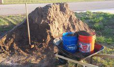 very small wheelbarrow moving a mountain of dirt. Building Raised Garden Beds, Outdoor Settings, Coffee Cans, Wheelbarrow, Mountain, Diy, Bricolage, Diys, Handyman Projects