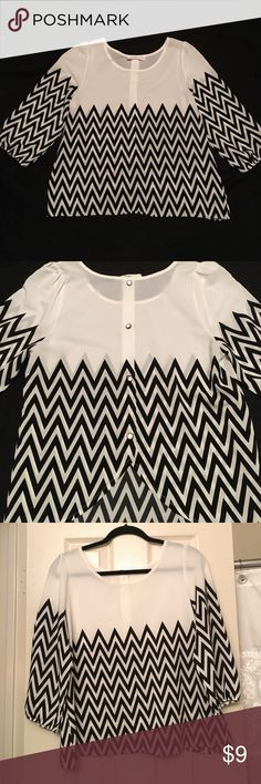 Black and white chevron top White polyester top with black chevron pattern. Buttons down back of shirt are embellishments only. Buttons are white with gold trim. Fabric makes an upside-down V at base of back. Originally purchased at boutique in Norman, OK. peach love cream Tops Blouses