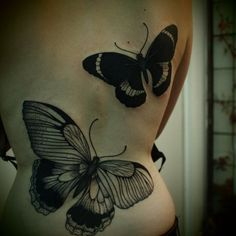 These two huge butterfly tattoos are very dark but they look good if that is what you are aiming for.