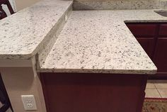 Branco-Dallas-Granite-Countertops-in-Kitchen-with-High-Bar.jpg