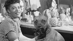 | Holiday poses with her dog Mister in her dressing room in 1946.