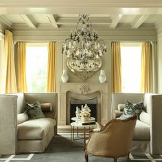 Gorgeous chandelier in a bright and inviting sitting room.