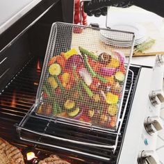 Sur La Table Flippin' Easy Grill Basket. Check out all their outdoor cookware....there are soooo many great pieces!