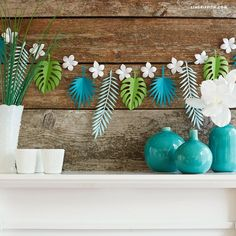 Browse our decor ideas for hosting your own summer luau! Download our templates to make this tropical leaf paper garland to hang around your special event