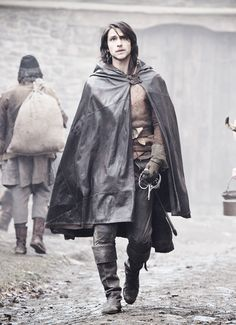 I like the hair and the outfit. Except the cape makes him look like he's wearing a garbage bag. :)