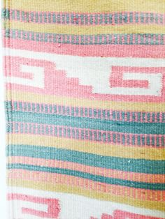 A lovely vintage Southwestern rug woven from a colorful blend of pastel wool threads. Via SergeantSailor on Etsy