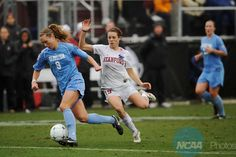 06 DEC 2009:  Whitney Engen (9) of the University of North Carolina dribbles past Kelley O'Hara (19) of Stanford University during the Division I Women's Soccer Championship held at Aggie Soccer Stadium on the Texas A&M University campus in College Station, TX.  North Carolina defeated Stanford 1-0 for the national title.  Brett Wilhelm/NCAA Photos