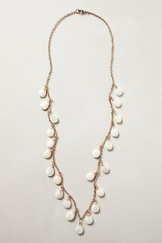 Anthro necklace with beautiful white teardrop beads on gold colored chain. I love this style so much.