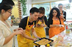 Students learning how to make Mid-Autumn festival treats Yuè Bing (mooncakes) at our Chinese cooking class.  Join us at our Beijing or Shanghai campus for Chinese cooking classes or a range of cultural activities and language learning