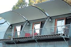 "THREE PHOTOS: Innovations such as the automated ""wing"" windows allow cool breezes in and air-lock when closed to trap heat. Metal Building Homes, Metal Homes, Building A House, Green Building, Hut House, Dome House, Quonset Hut Homes, Haus Am See, Arch House"