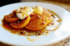 Delicious, moist pumpkin batter for silver dollar---or regular---pancakes! Maple whipped cream and a sprinkling of nuts make them irresistible.