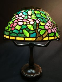 "Apple Blossom -- Tiffany interpretation stained glass lamp by Coughran Studio. Listed in ""Going Green Like Spring"" Etsy Treasury."