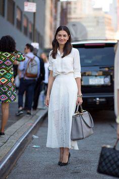 White oxford, white pleated maxi skirt, black heels, and light grey handbag