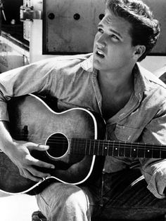 So . . . I'm an Elvis fan.  I love a lot of his music, and pre-bad hair and horrible jumpsuits and all that . . . holy sugar, that man was FINE!