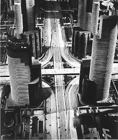 Freeways intersecting in city center, General Motors' Futurama, 1939  Of course, designed for the automobile.
