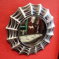 "9.5"" Spiderweb Pinstriped Accent Mirror."