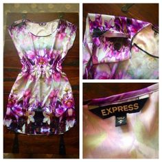 Floral dress Adorable purple floral dress with detail slits in the sleeves. Very elegant and slimming. Satan like material, from Express, only worn once. Express Dresses Midi