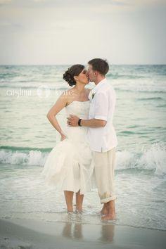 bride and groom on beach, beach weddings (pensacola beach weddings)