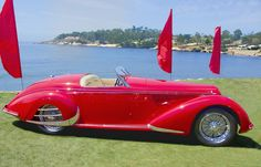 https://flic.kr/p/yca4Mb | Alfa Romeo 8C 2900B Lungo Touring Spider | It's all about RED.  And no, I did not change the color of the flags to match; or the car to match the flags:-))  Pebble Beach Concours d'Elegance 2015